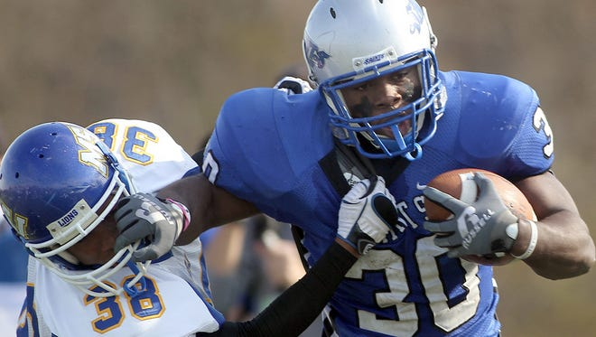 Thomas More running back Domonique Hayden worked out with a scout from the Detroit Lions.