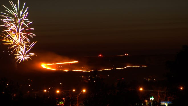 A grass fire ignites on Hill 57  in southwest Great Falls shortly after the city fireworks display ended on July 4, 2012.