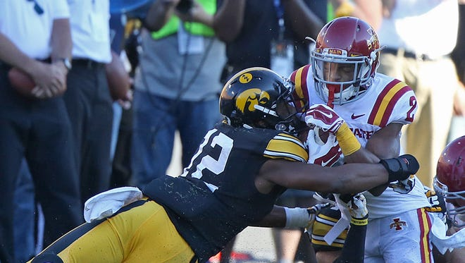 Iowa's Anthony Gair, left, helps to tackle Iowa State's Aaron Wimberly in last weekend's Cy-Hawk game at Kinnick Stadium. Gair entered for Jordan Lomax in the fourth quarter after Lomax was ejected for a targeting foul.