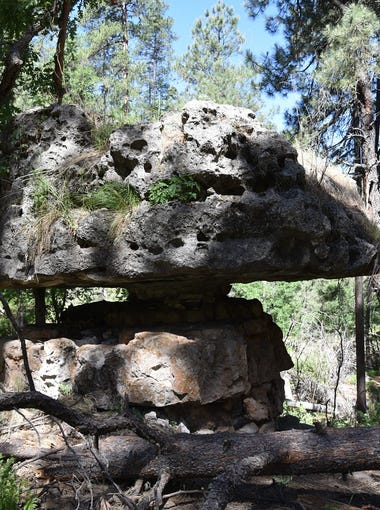 Pivot Rock consists of a foundation supporting a huge balancing capstone.