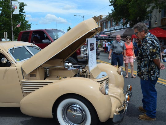Jack Roesly of Cedarville looks at this 1936 Cord 810 Westchester that was displayed at the Millville Car Show along High Street on Saturday.