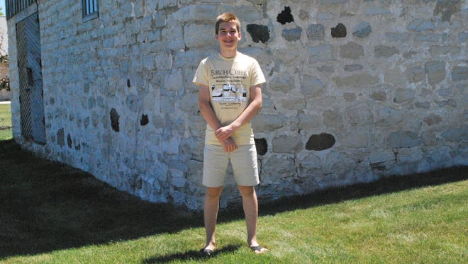 David Pickar stands outside Birch Creek's century-old concert barn while attending music camp in Egg Harbor.