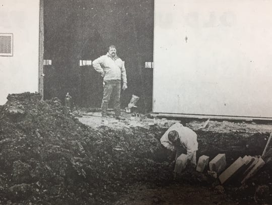 Tony Trainer (standing) and Bill Webb worked on installing