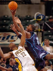 10/14/06 --- Indiana Pacers' Josh Powell,left, takes a charge from the driving Utah Jazz's C.J. Miles (#34),right, in the fourth quarter of their pre-season game Saturday night at Conseco Fieldhouse. (Matt Kryger / The Star) with spPACERS15 stories, file #131875