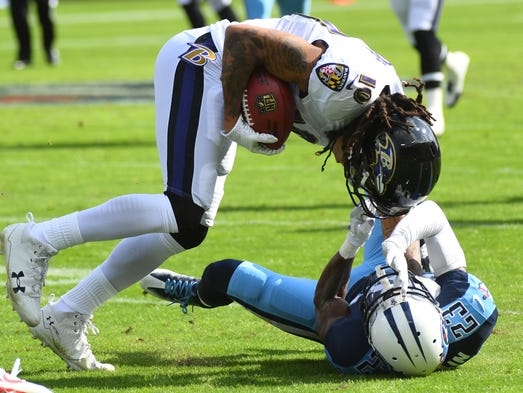 Baltimore Ravens receiver Chris Moore is tackled by