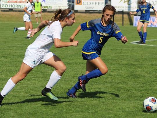 Marian's junior defender Neve Badalow (5) beats Northern