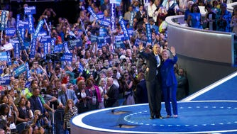 Hillary Clinton and President Obama wave to the delegation on July 27, 2016, at Wells Fargo Arena in Philadelphia.