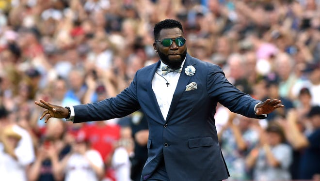 Red Sox former designated hitter David Ortiz walks onto the field during pre game ceremonies.