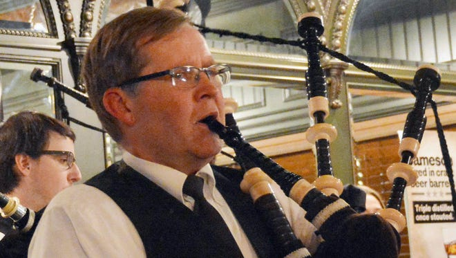 In this Jan. 9, 2016 photo, Brandon Police Chief Dave Kull performs a solo verse of Amazing Grace during a performance by Dakota District Pipes & Drums at McNally's Irish Pub in Sioux Falls, S.D. The group, which has been playing for 18 years, played as part of a celebration of Scottish poet Robert Burns. (AP Photo/Dirk Lammers)