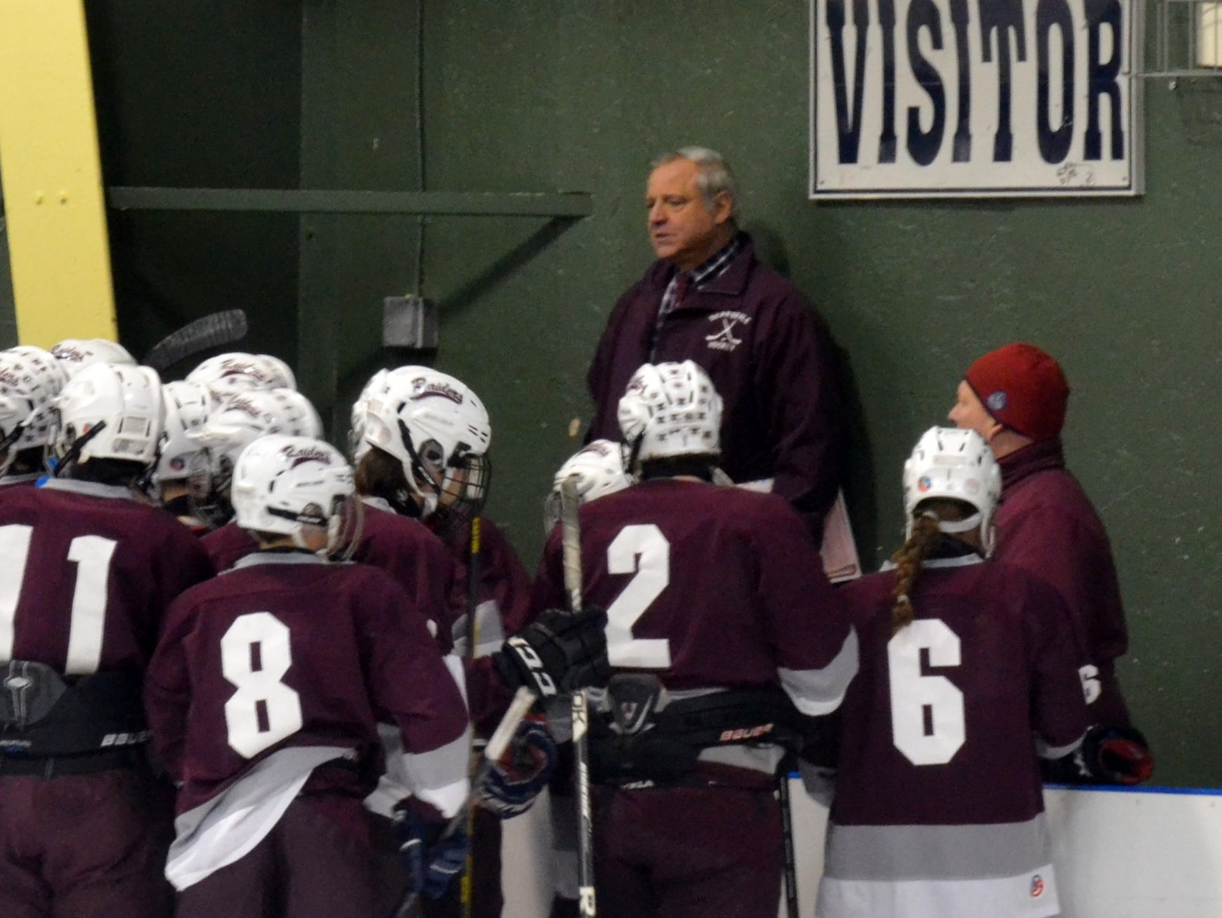 In this file photo, Scarsdale hockey coach Jim Mancuso gives last-minute instructions to his team before a regional win at Shenendehowa in March 2014. Mancuso is one of four varsity coaches who won't be returning to Scarsdale in the 2016-17 school year.