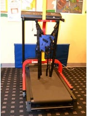 A LiteGait (seen here attached to a treadmill) safely