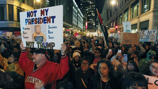 Anti-Trump protesters march on Wisconsin Avenue in Milwaukee to protest President-elect Donald Trump two days after the election.
