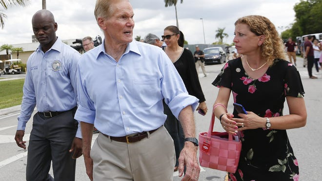 State Rep. Kionne L. McGhee, D-Miami, U.S. Sen. Bill Nelson, D-Fla., and U.S. Rep. Debbie Wasserman Schultz, D-Fla., walk across the street to the Homestead Temporary Shelter for Unaccompanied Children in Homestead, Fla. They were denied access to the facility.
