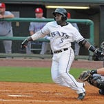 Jermaine Curtis takes a swing during a July 1 Louisville Bats game.