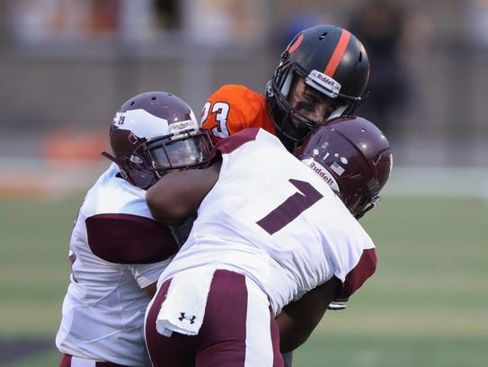 Dearborn's Youseph Saad is tackled by Romulus defenders