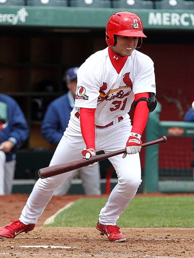 The Springfield Cardinals' Aledmys Diaz lays down a bunt against the Corpus Christi Hooks at Hammons Field on April 8, 2014.