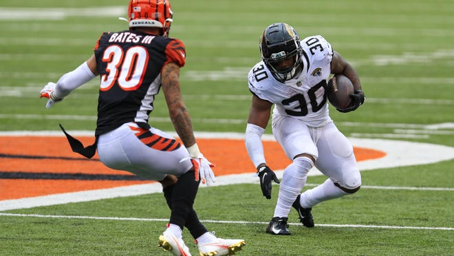 Jacksonville Jaguars running back James Robinson (30) cuts away from Jacksonville Jaguars running back James Robinson (30) in the second half of a game in Cincinnati on Sunday.