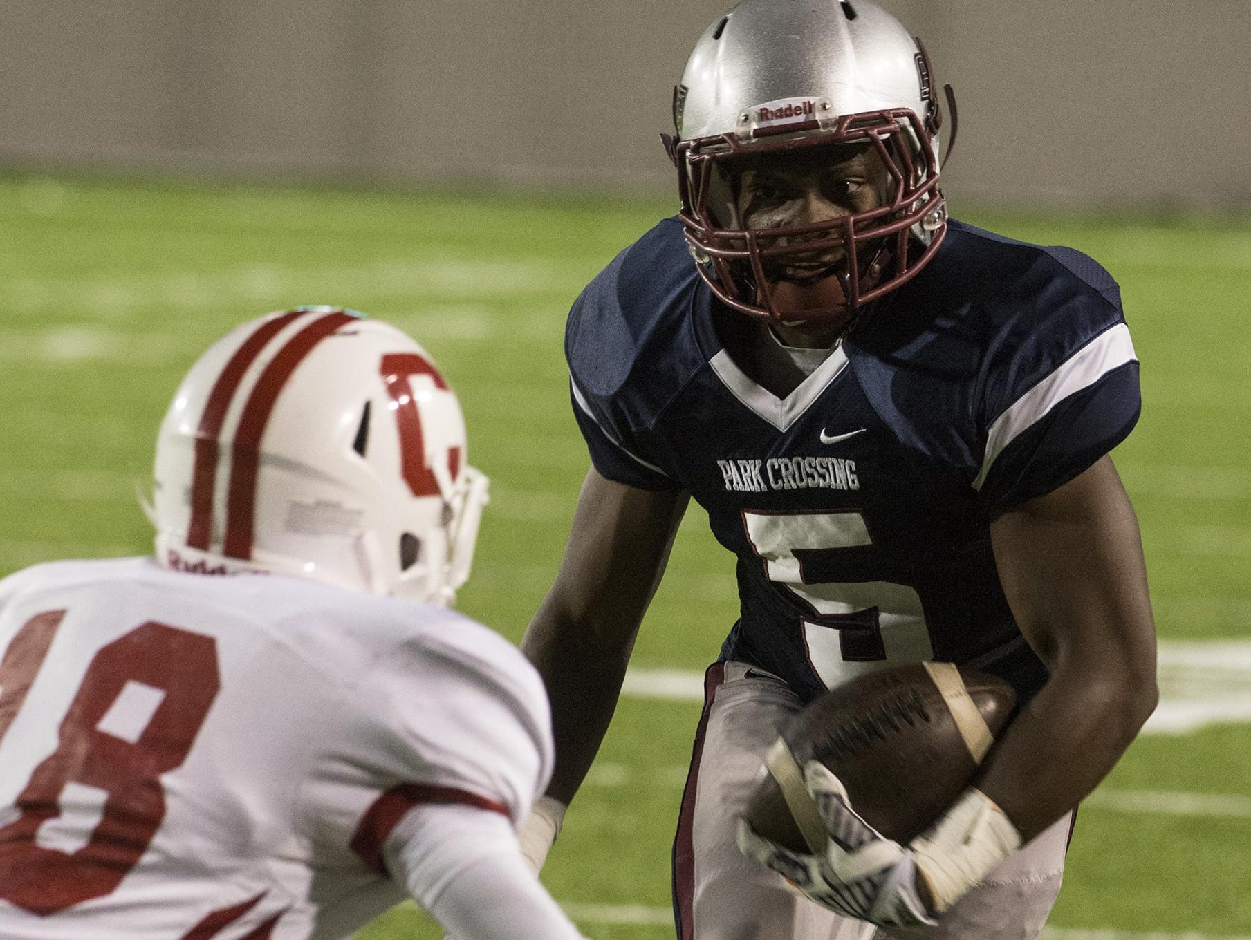 Park Crossing's Steven Hodges (#5) looks for room to run. Thunderbirds take on the Carroll Eagles in Park Crossing's homecoming game Friday, Sept. 18, 2015.