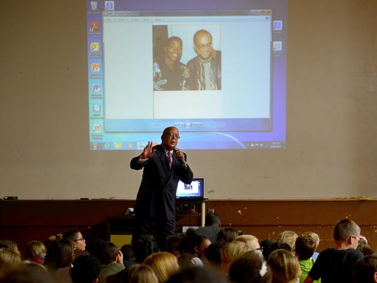 In front of a photo of him and Isiah Thomas, Ingham County Judge Hugh Clarke Jr., talks to students at Hope Middle School in Holt. Clarke was speaking to them about the HistoryMakers project. HistoryMakers is a nationwide effort to explain the importance of education and tell the story of well-known and unsung African Americans.