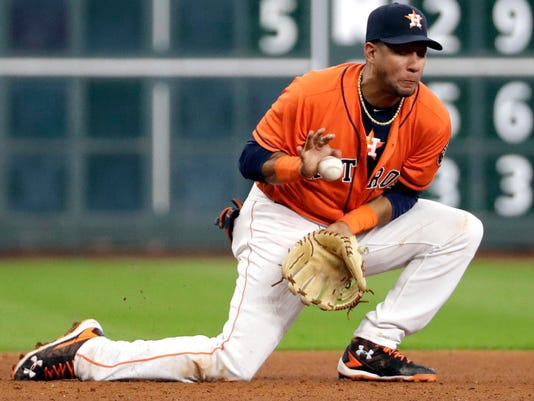 A ground ball hit by Los Angeles Angels' Carlos Perez bounces off Houston Astros third baseman Yulieski Gurriel during the fourth inning of a baseball game Friday, Sept. 23, 2016, in Houston. Perez was out at first on the play. (AP Photo/David J. Phillip)