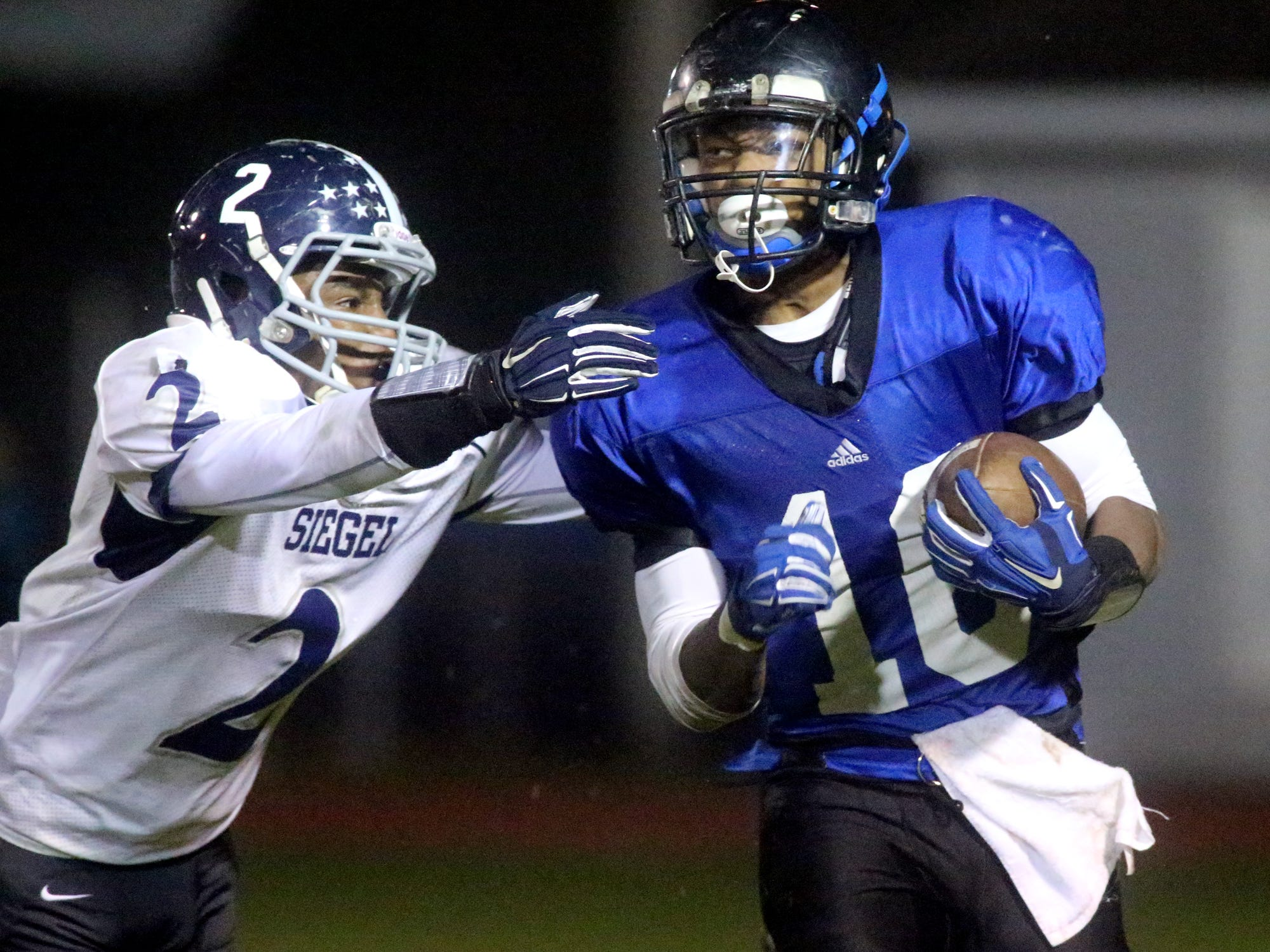La Vergne's Roshea Grays runs the ball as Siegel's Marcus Wilson moves in for the tackle in the second quarter of the game at La Vergne, on Thursday Oct. 30, 2014.