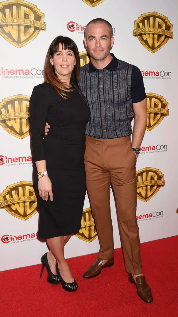 Director Patty Jenkins, left, poses with actor Chris