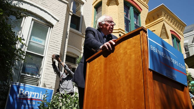 Bernie Sanders speaks to the media outside of his campaign headquarters on June 14, 2016, in Washington.