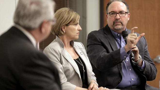 The El Paso Times' Executive Editor Robert Moore, left, hosted a town hall meeting Wednesday with El Paso Independent School District Superintendent Juan Cabrera and board president Dori Fenenbock. Community members were given a chance to ask questions about the $668.7 million bond via Facebook Live and via elpasotimes.com as the meeting streamed.