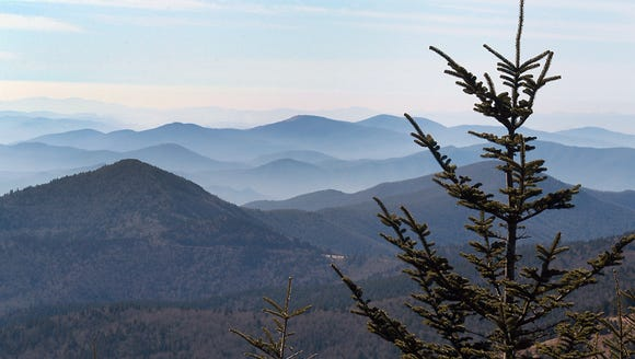 View from the top of Mount Mitchell. The state park Mitchell State Park and west into Buncombe County.