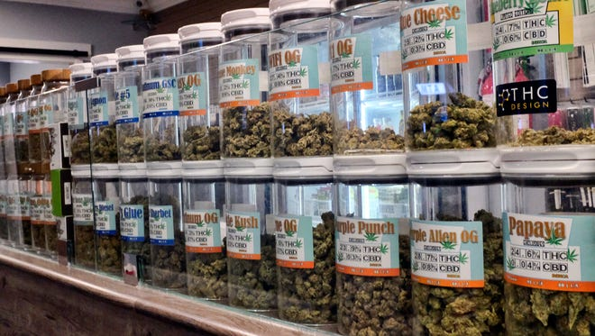 FILE - This Friday, Nov. 3, 2017 photo shows jars of medical marijuana on display on the counter of Western Caregivers Medical marijuana dispensary in Los Angeles.