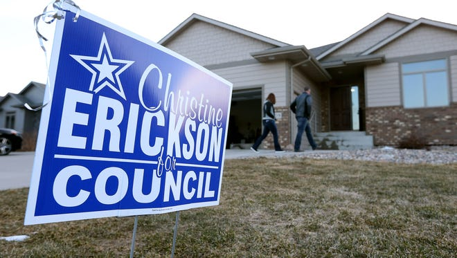 Family and friends gather at Christine Erickson's house while waiting for election results to come in Tuesday night in Sioux Falls, S.D.