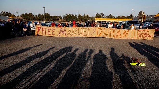 Community members attend a vigil in support of Manuel Duran, a reporter for a Spanish-language media, who was arrested last week while doing a live Internet video of a Memphis protest. Manuel, has since been transferred to an immigration detention center in Louisiana.