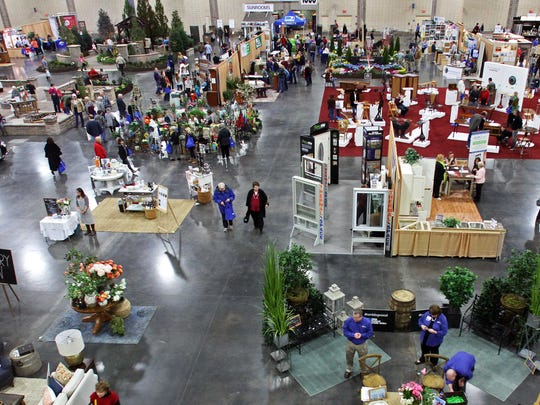 Guests walk through the isles during the annual Dogwood Arts House and Garden Show at the Knoxville Convention Center Saturday, Feb. 14, 2015, in Knoxville. (Photo by Wade Payne, Special to the News Sentinel)
