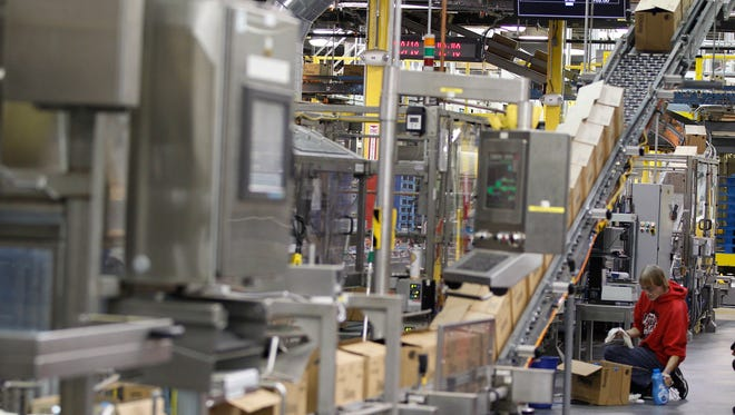Downy fabric softener moves on the production fill line at a P&G plant in Lima, Ohio.