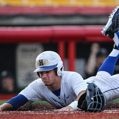 Brady Murray slides safely across the plate with Highlands'
