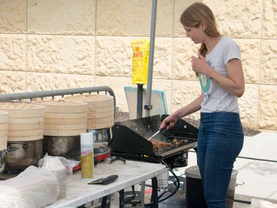 Dumpling Darling hosted a tent with cooked food at CelebrAsian, Friday, May 26, 2017, at Western Gateway Park in Des Moines.