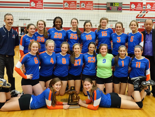 Ladywood's volleyball team poses with the Class B district