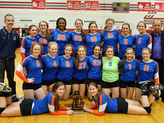 Ladywood's volleyball team poses with the Class B district championship trophy it earned Friday night at Clarenceville.