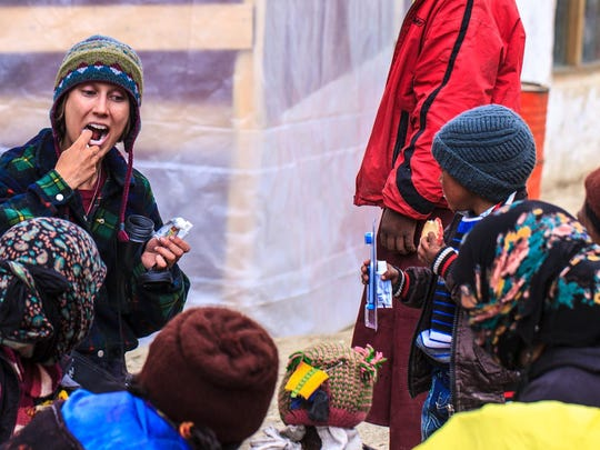 Volunteers with the Tibetan Children's Education Foundation teach kids about brushing teeth during one of their recent trips to the Zanskar region of India.
