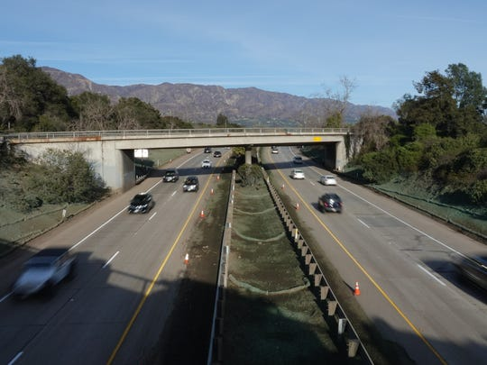 On Jan. 21, cars and trucks filtered onto Highway 101 after Caltrans quietly reopened the freeway, as seen from the Olive Mill Road overpass in Montecito. The highway had been closed since deadly mud and debris flows hit the community Jan. 9. A quarter-mile section under the Olive Mill Road crossing was mired in mud and water more than 10 feet deep in some places.
