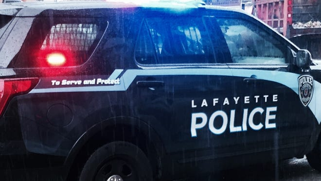 A Lafayette man took a punch for a would-be victim during a neighborly dispute Sunday, police said.