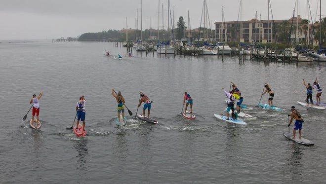 Paddlers take to the water in the 2015 Neptunalia in the Indian River.