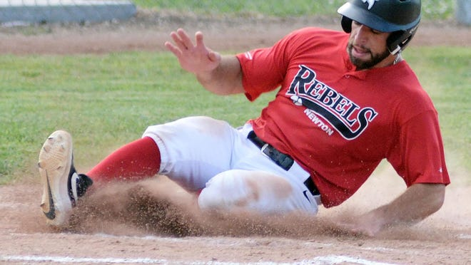 Newton Rebel Enzo Bonventre slides into home for a run during play Friday against the Great Bend Bat Cats.