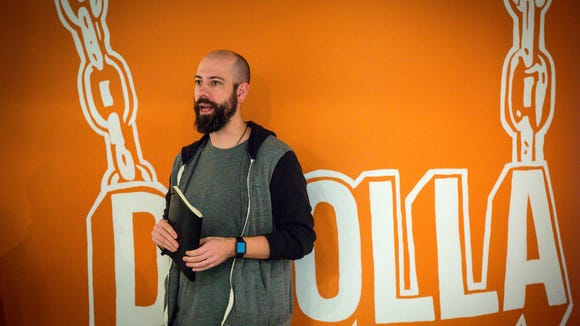 COE Ben Milne talks to the group at  Dwolla's hackathon Wednesday Jan. 25, 2017, in their Des Moines' office, where staff members pitch various ideas for projects and new ideas to finish in a short time.