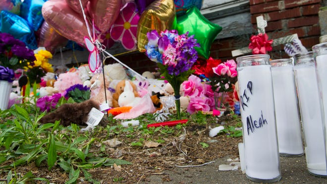 A memorial is set up for Aleah Beckerle outside of 1628 South Bedford Avenue, Thursday, March 30, 2017. The body of Aleah Beckerle was was discovered in the vacant home on Monday evening.