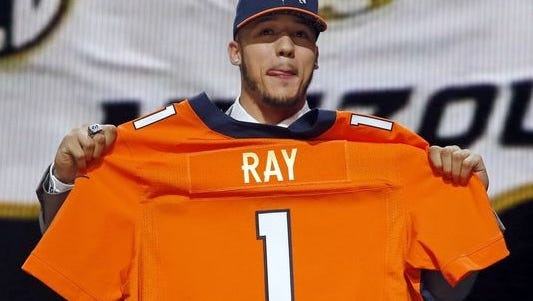 Missouri defensive lineman Shane Ray poses for photos after being selected by the Denver Broncos as the 23rd pick in the first round of the 2015 NFL Draft, Thursday, April 30, 2015, in Chicago.