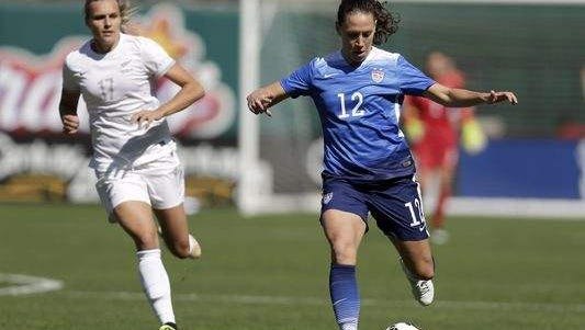 Former Ben Davis High School standout Lauren (Cheney) Holiday (right) plays in an exhibition game for the U.S. against New Zealand in St. Louis April 4.