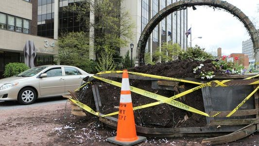 The giant flower basket planter at Mitchell Place and South Broadway in White Plains was damaged in an early morning accident, May 4, 201