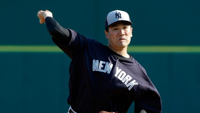 New York Yankees' Masahiro Tanaka pitches against the Washington Nationals in the first inning of a spring training baseball game, Wednesday, March 23, 2016, in Viera, Fla.