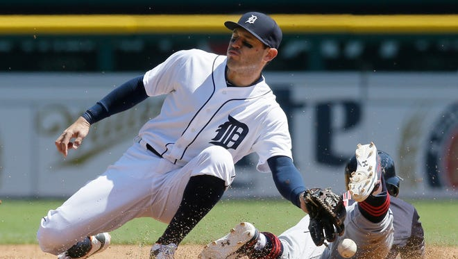 Detroit Tigers second baseman Ian Kinsler bobbles the ball as Cleveland Indians' Francisco Lindor safely steals second during the third inning of a baseball game, Saturday, April 23, 2016, in Detroit.